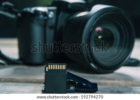Digital photo camera and memory cards, space for text