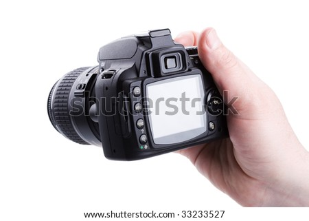 digital photo camera in hand isolated on white