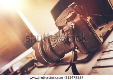 Shutterstock Digital Photography Workstation. Modern Digital DSLR Camera, Laptop Computer and Display.