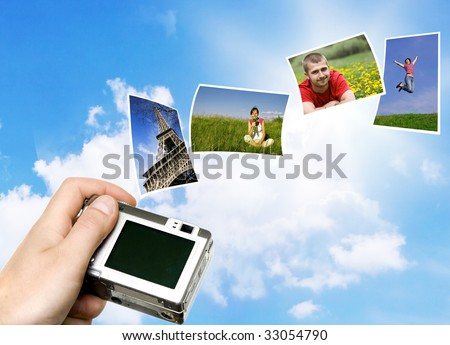 Digital point and shoot camera and pictures against blue sky