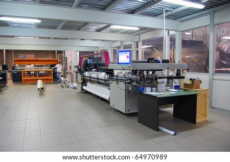 Digital printing system for printing a wide range of superwide-format applications. These printers are generally roll-to-roll and have a print bed that is 2m to 5m wide. - stock photo