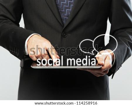 digital table in hand, social media concept