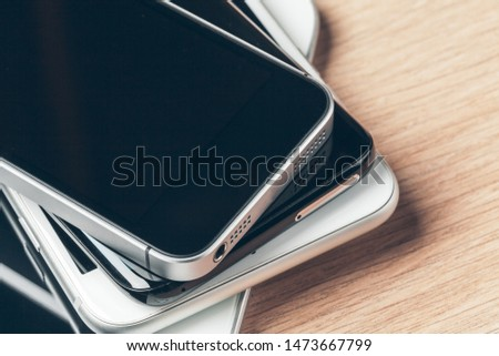 Digital tablet and mobile phone. Electronic devices on wooden table, close up. #1473667799