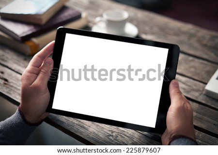 Digital tablet computer with isolated screen in male hands over cafe background - table, cup of coffee... #225879607
