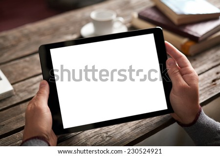 Digital tablet computer with isolated screen in male hands over cafe background - table, cup of coffee... #230524921