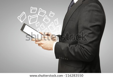 digital tablet in hand and folder icon
