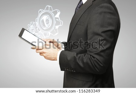 digital tablet in hand and gears symbol