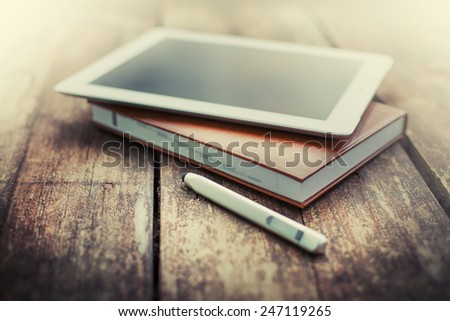 Digital tablet  on old wooden desk. Simple workspace or coffee break in morning/
