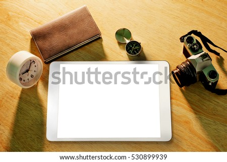 Photo of Digital tablet on wood table with free space.