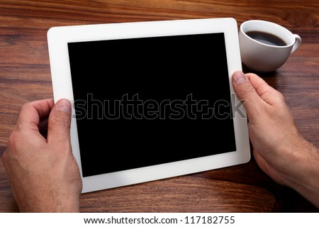 Digital tablet with blank screen in coffee shop