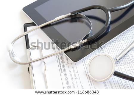 Digital tablet with stethoscope and paperwork
