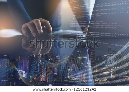 Digital technology, software development, IoT concept. Double exposure, man programmer, software developer working on laptop computer and smart city with big data, internet network, computer code