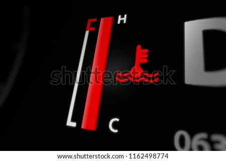 Digital Temperature Gauge  With Engine Temperature Warning Light on Car Dashboard. 3D illustration.