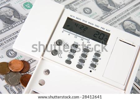 digital thermostat on money background