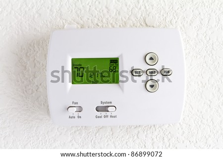 digital thermostat on white wall