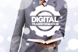 Digital Transformation Education Business Technology. Digitilization. Digitization Learning concept. Man offers book with gear and digital transformation words.