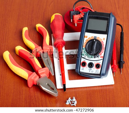Digital volt meter, electrical tools, tape - stock photo