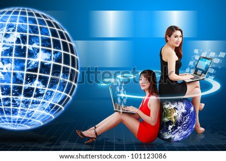 Digital world and Lady use computer : Elements of this image furnished by NASA
