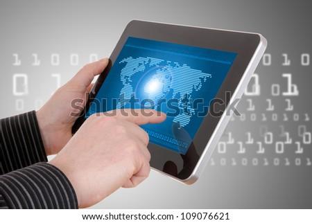 Digital world concept graphic, including digital map on tablet, in businessman's hands