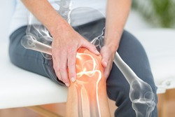Digitally generated image of man suffering with knee pain