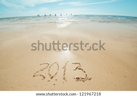 digits 2013 on the sand seashore - concept of new year