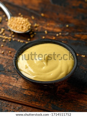 Dijon mustard in bowl on wooden table. Foto stock ©