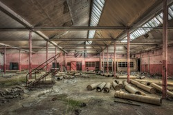 Dilapidated hall in an abandoned factory, HDR processing