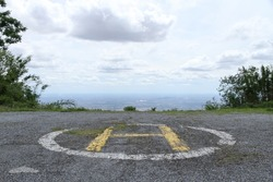 Dilapidated Helipads on the mountain. Abandoned old helipads. (The pictures has noise and soft focus)