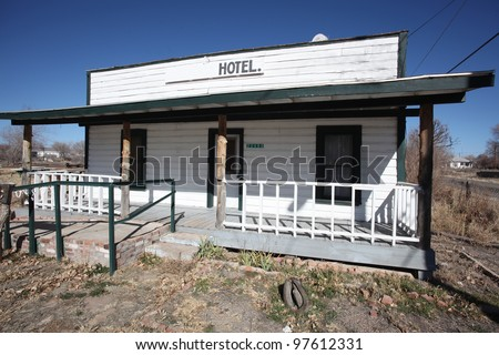 Dilapidated hotel Along Route 66/Small building with hotel sign on roof in Seligman, Arizona, although seemingly disused, it sports a proper handicapped access  ramp.