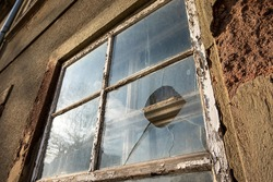 Dilapidated old house, broken window