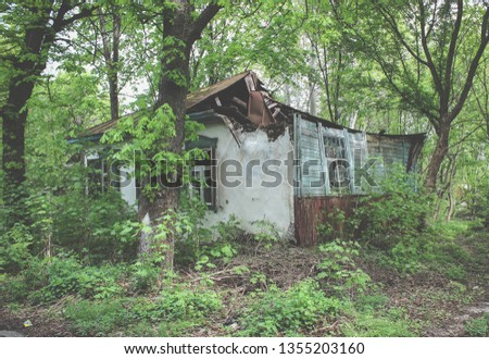 Dilapidated private house. Abandoned building in Pripyat. Collapsed roof. Housing abandoned after the accident at the Chernobyl nuclear power plant.