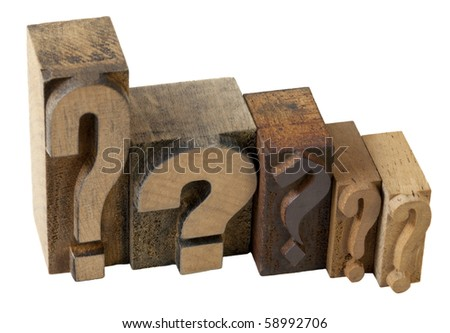 dilemma concept - 5 questions marks in vintage wooden letterpress printing blocks, isolated on white
