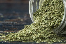 Dill Weed Spilled from a Spice Jar
