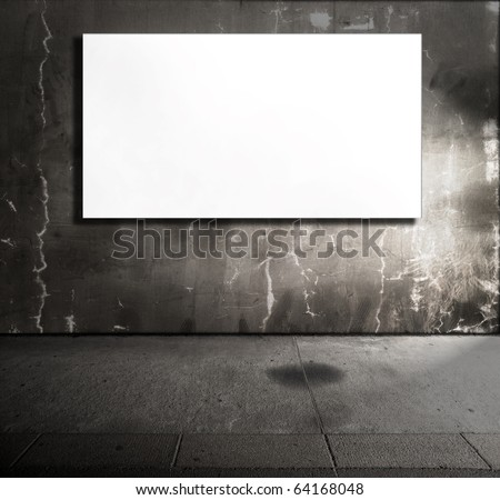 Dim stone room with white screen board. - stock photo