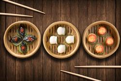 Dim Sum dumplings on a wooden background