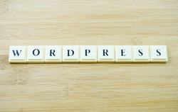 Dimensional word with  Wordpress  over wooden background