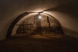 Dimly lit abandoned basement in a castle