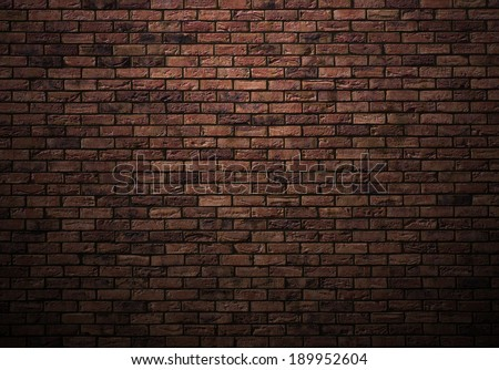 dimly lit old brick wall #189952604