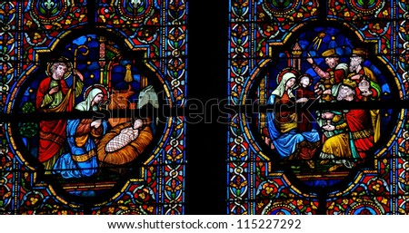 DINANT - OCTOBER 19: Stained glass window depicting Nativity Scene on Christmas and the Visit of the Three Magi in the cathedral of Dinant, Belgium, on October 19, 2011.