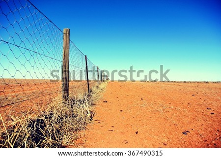 Dingo fence in the Australian outback #367490315