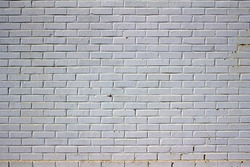 Dingy and worn white-painted brick wall texture background
