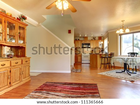 Dining  and living room and large area near kitchen home interior.