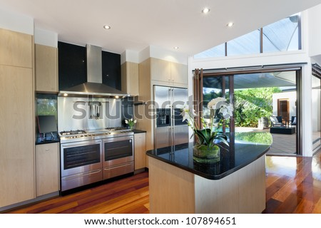 Dining area and kitchen in stylish Australian home
