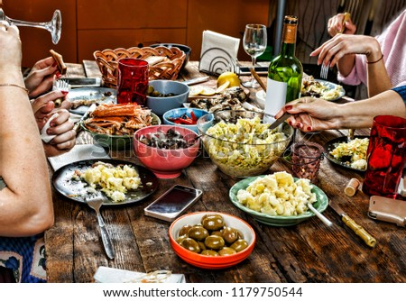 Dining family table. Easter. Various snacks and Easter wine. #1179750544