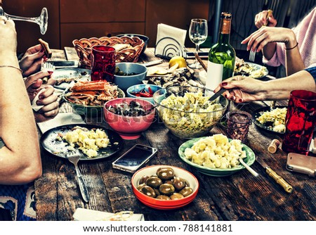 Dining family table. Easter. Various snacks and Easter wine. #788141881