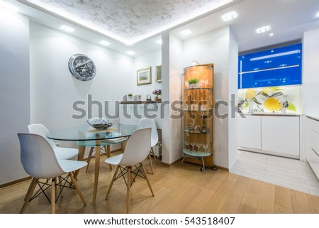Dining room and kitchen in modern apartment interior #543518407