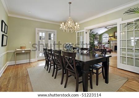 Dining room in luxury home with door to patio