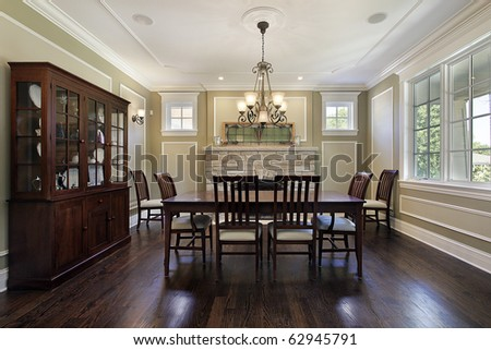 Dining Room In Luxury Home With Stone Fireplace Stock Photo ...