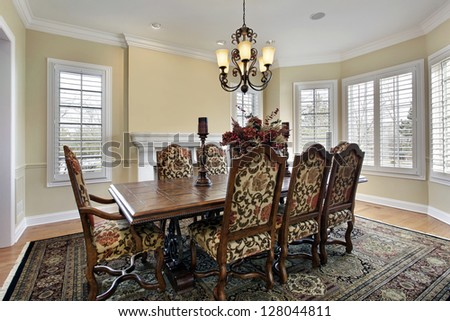 Dining room in luxury home with white fireplace