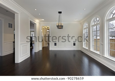 Dining room in new construction home with curved windows